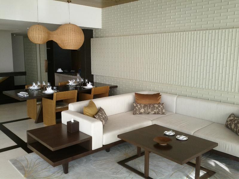 conrad-koh-samui-two-bedroom-villa-504-sitting-area-dinner-table