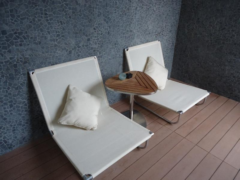 the-stones-hotel-legian-bali-suite-547-second-balcony-chairs